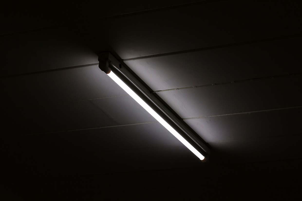 image of a overhead lighting unit where light blocking tape would be used