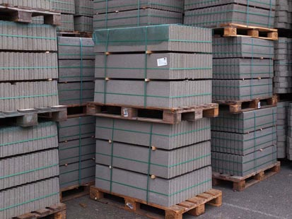 image showing stacked pallets with top sheets